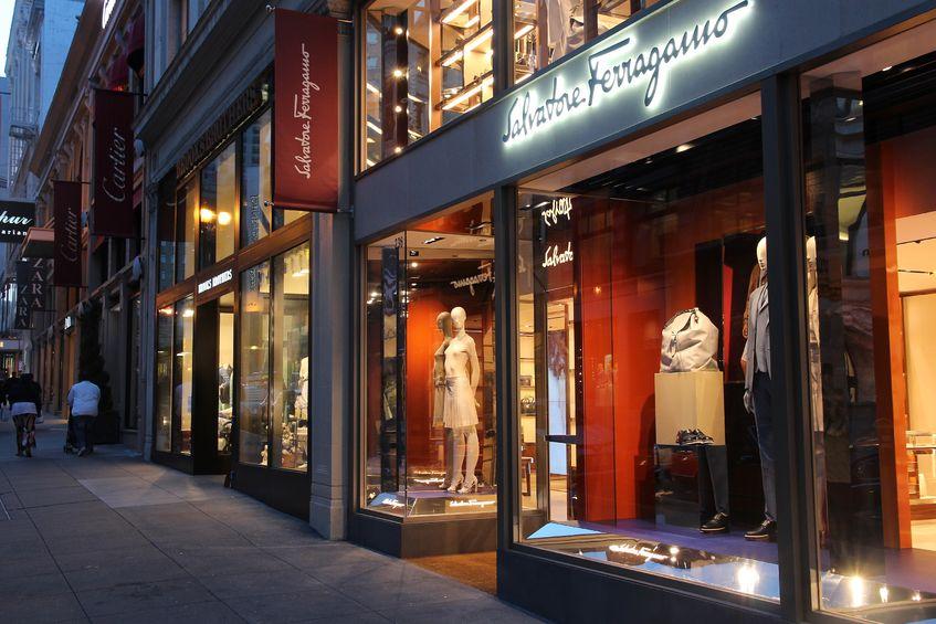 29853645 - san francisco, usa - april 8, 2014: people walk by salvatore ferragamo fashion store in san francisco, usa. salvatore ferragamo has 550 brand fashion stores.
