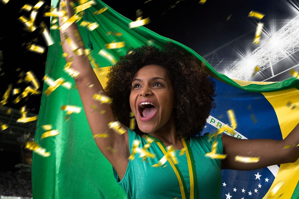 50373842 - brazilian woman celebrating in the stadium