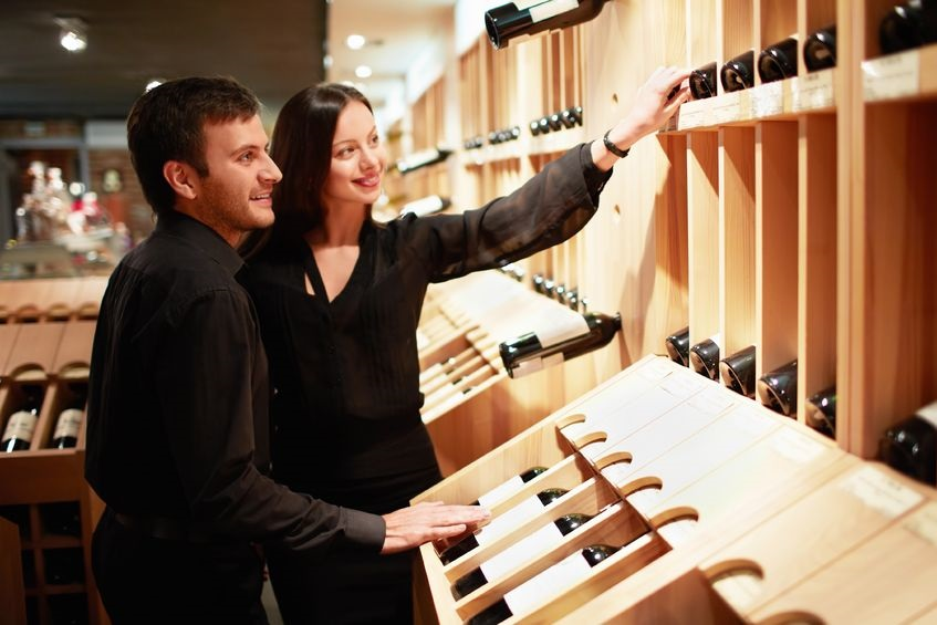 14446996 - young couple chooses the wine