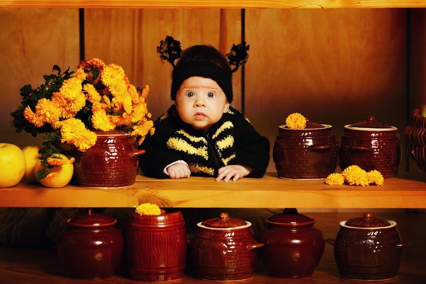 22345045 - little funny baby with bee costume