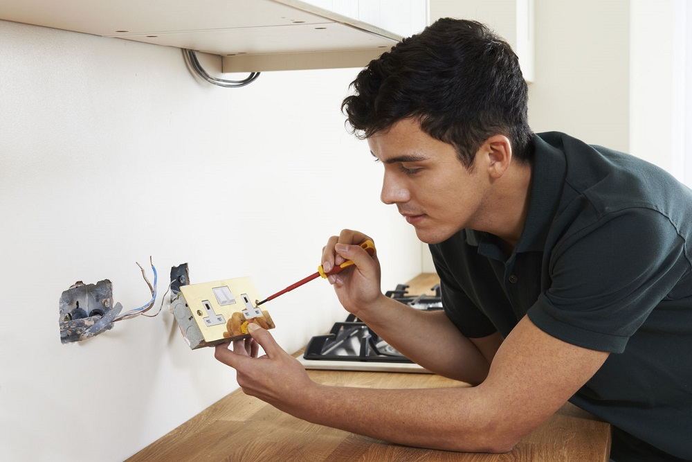 51674681 - electrician installing socket in new house