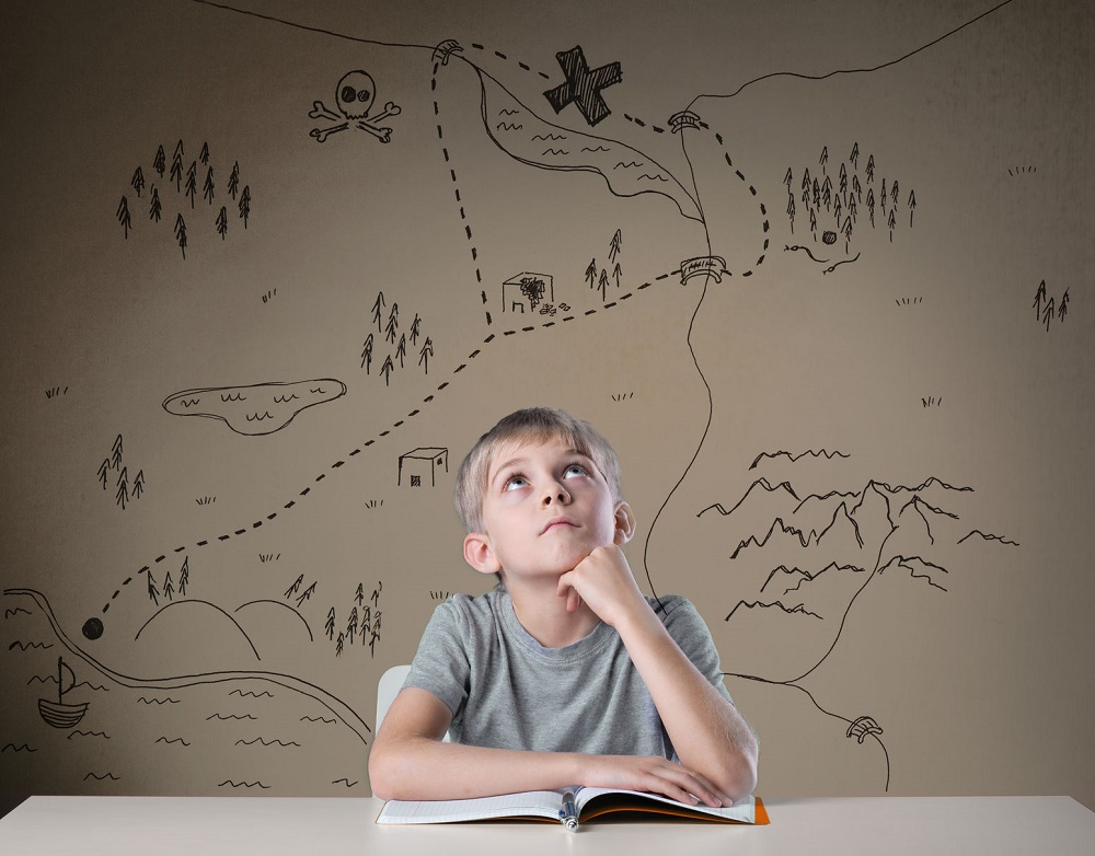 34709137 - little kid thinking about treasure map from his adventure book