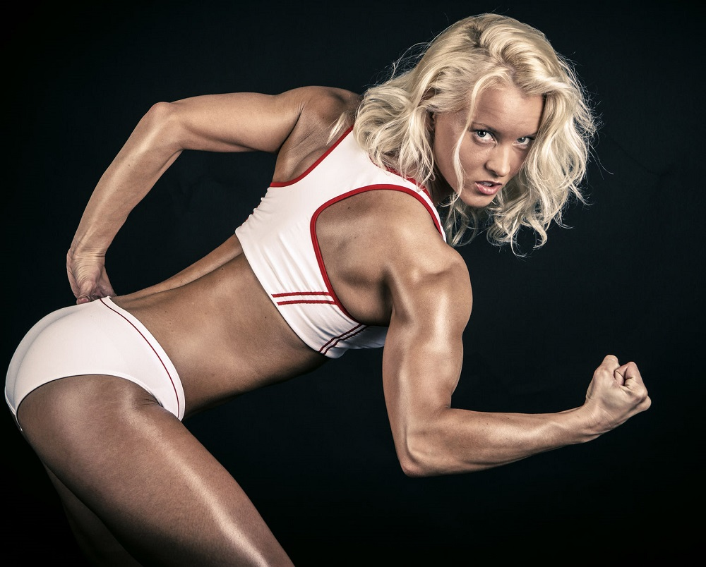 26135563 - blonde athlete striking a pose