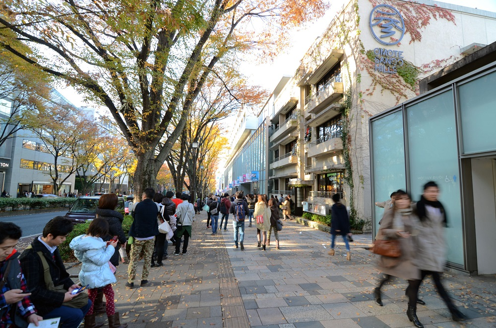 26944789 - tokyo - nov 24 people shopping in omotesando hills on november 2013,24 omotesando hills consists of six floors three are underground of about 100 upmarket shops, cafes, restaurants and beauty salons