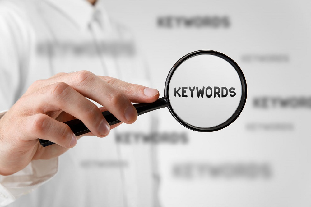 37393619 - find keywords concept. marketing specialist looking for keywords (concept with magnifying glass).