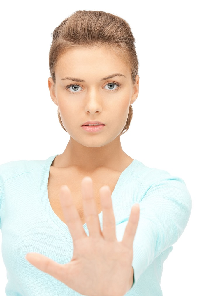 10792695 - bright picture of young woman making stop gesture