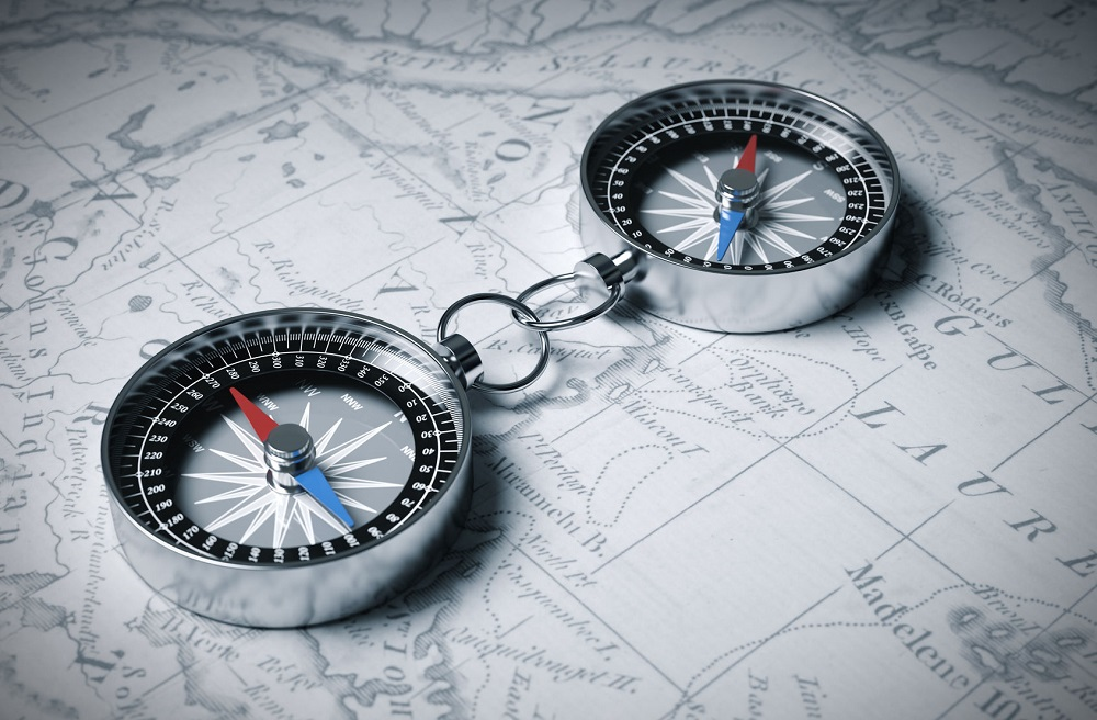 48989308 - two linked compass on the map. 3d scene.