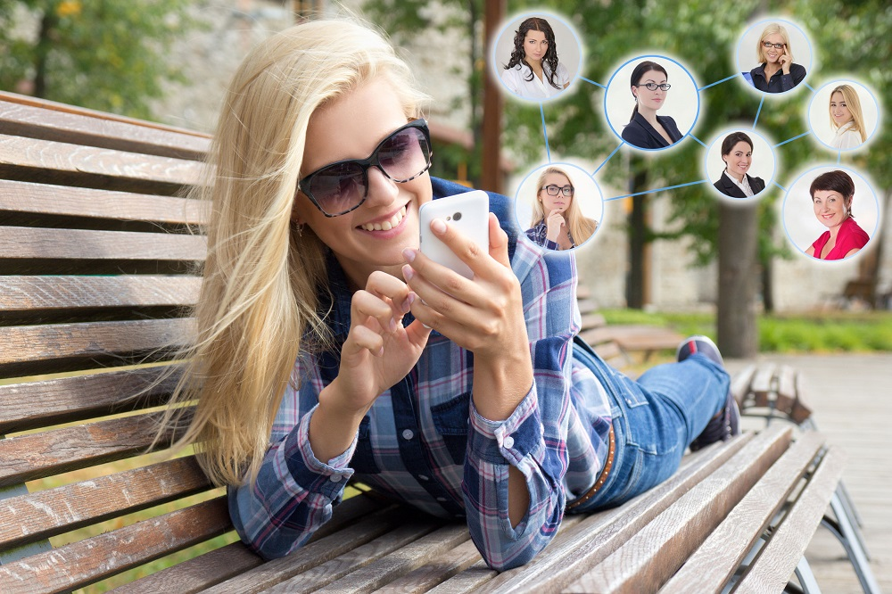 31858203 - social network concept - beautiful woman using smartphone and icons with people portraits