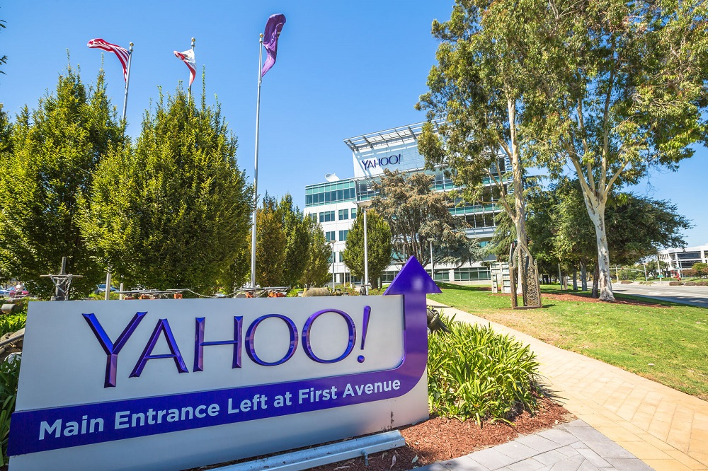 64421982 - sunnyvale, california, united states - august 15, 2016: yahoo headquarters with american flag and flag with yahoo icon on background.