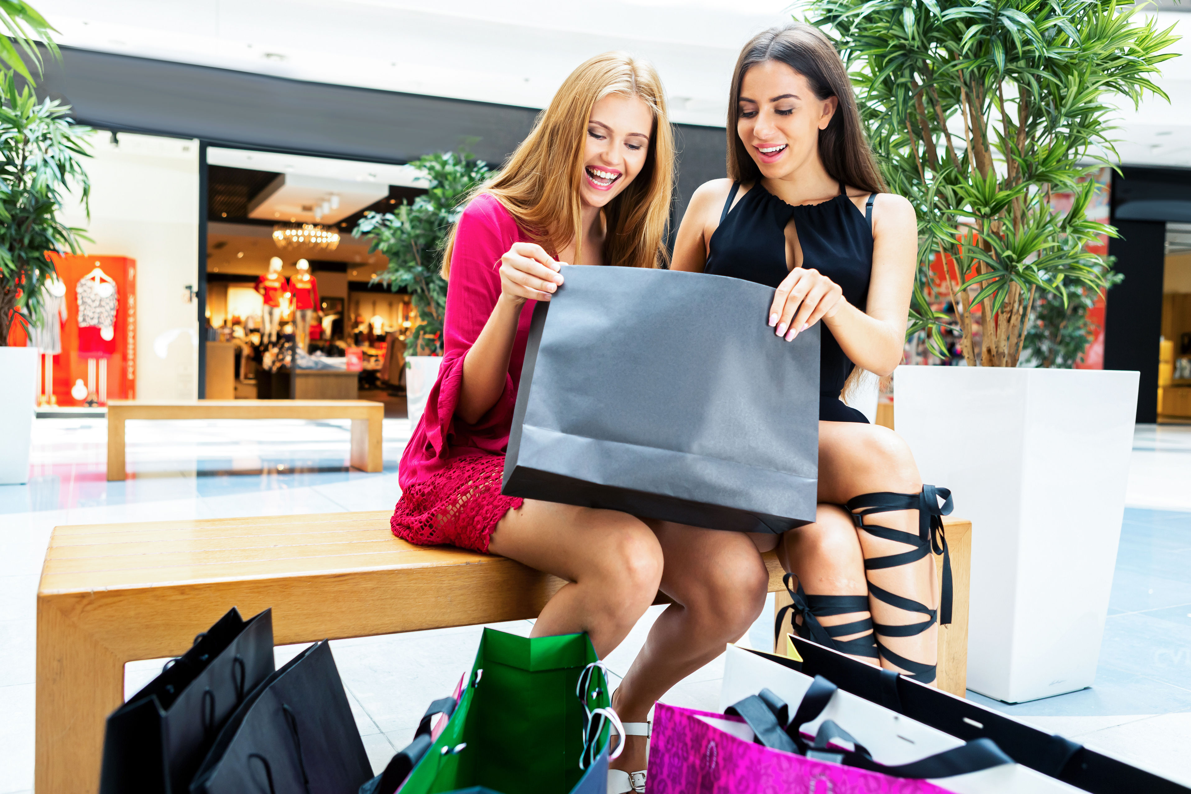 44190719 - the girls enjoy the acquired shopping in the store. it's a very happy day