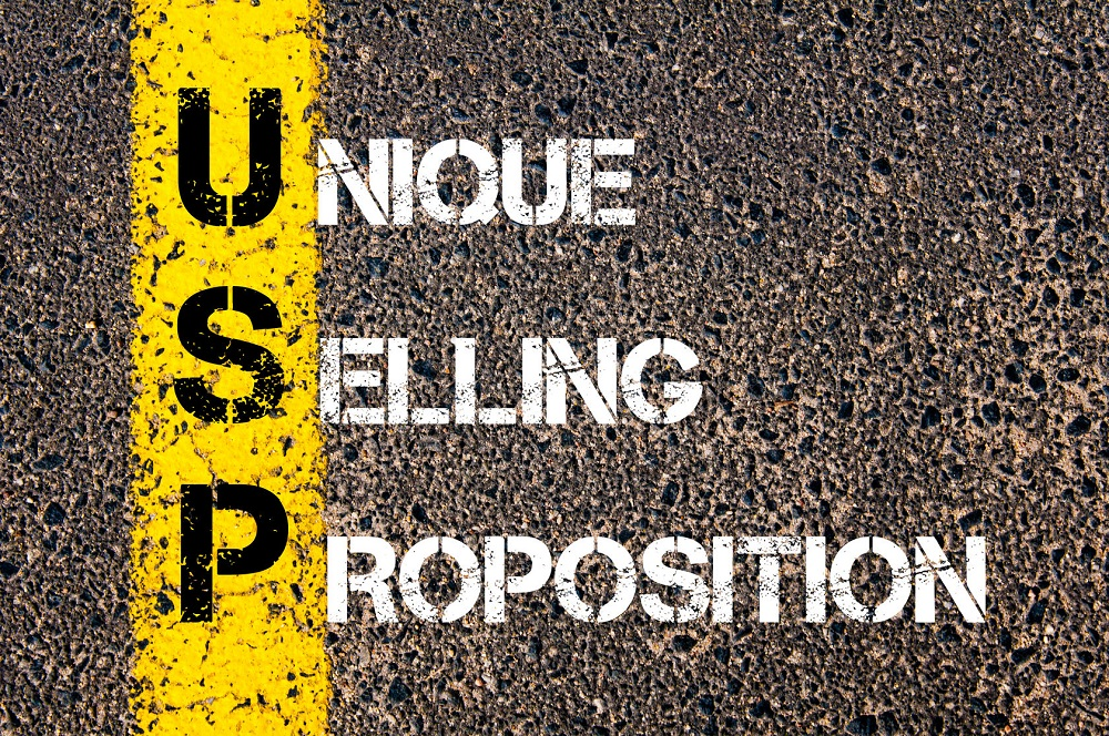 38836369 - business acronym usp as unique selling proposition. yellow paint line on the road against asphalt background. conceptual image